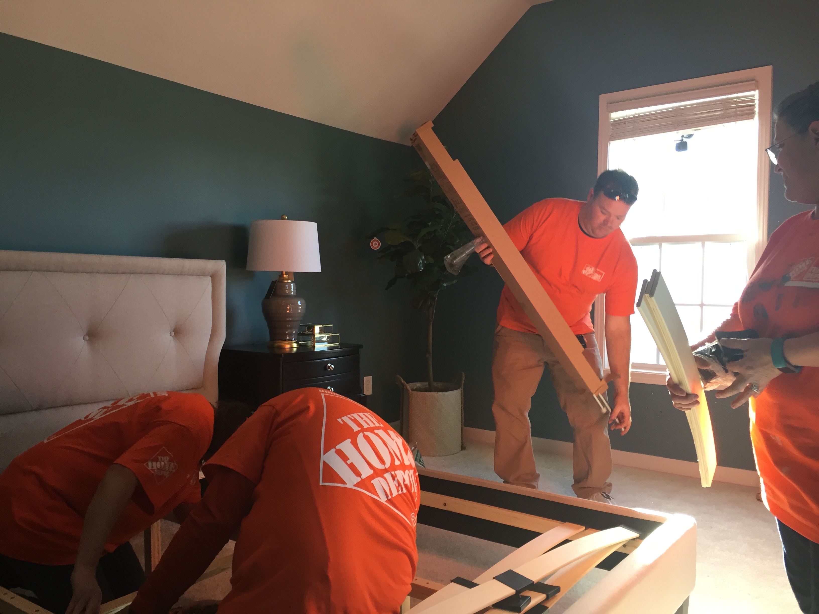 Team Depot builds bed in home makeover for veteran's widow.