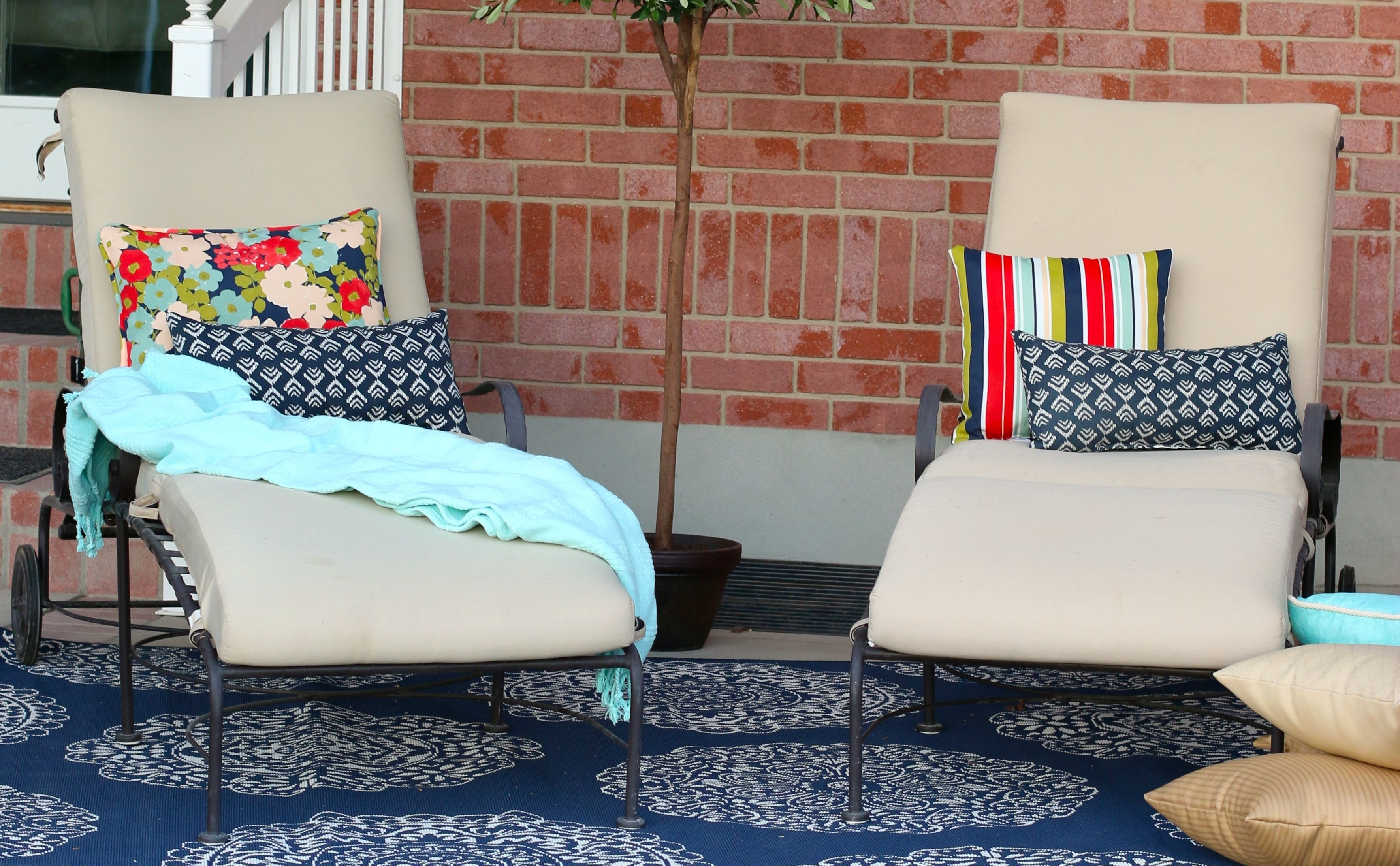 patio set from the home depot featuring brightly colored pillows and textured rug - Texture Patio Designs Home Depot