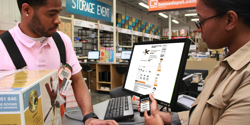 Home Depot associate helps customer with app