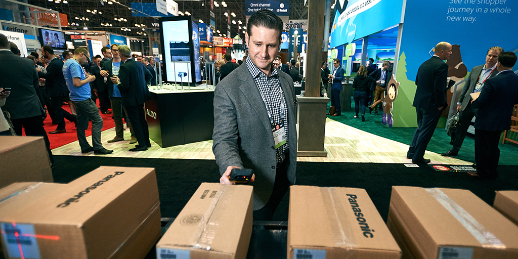 Matt Schweickert scans boxes at NRF tech expo
