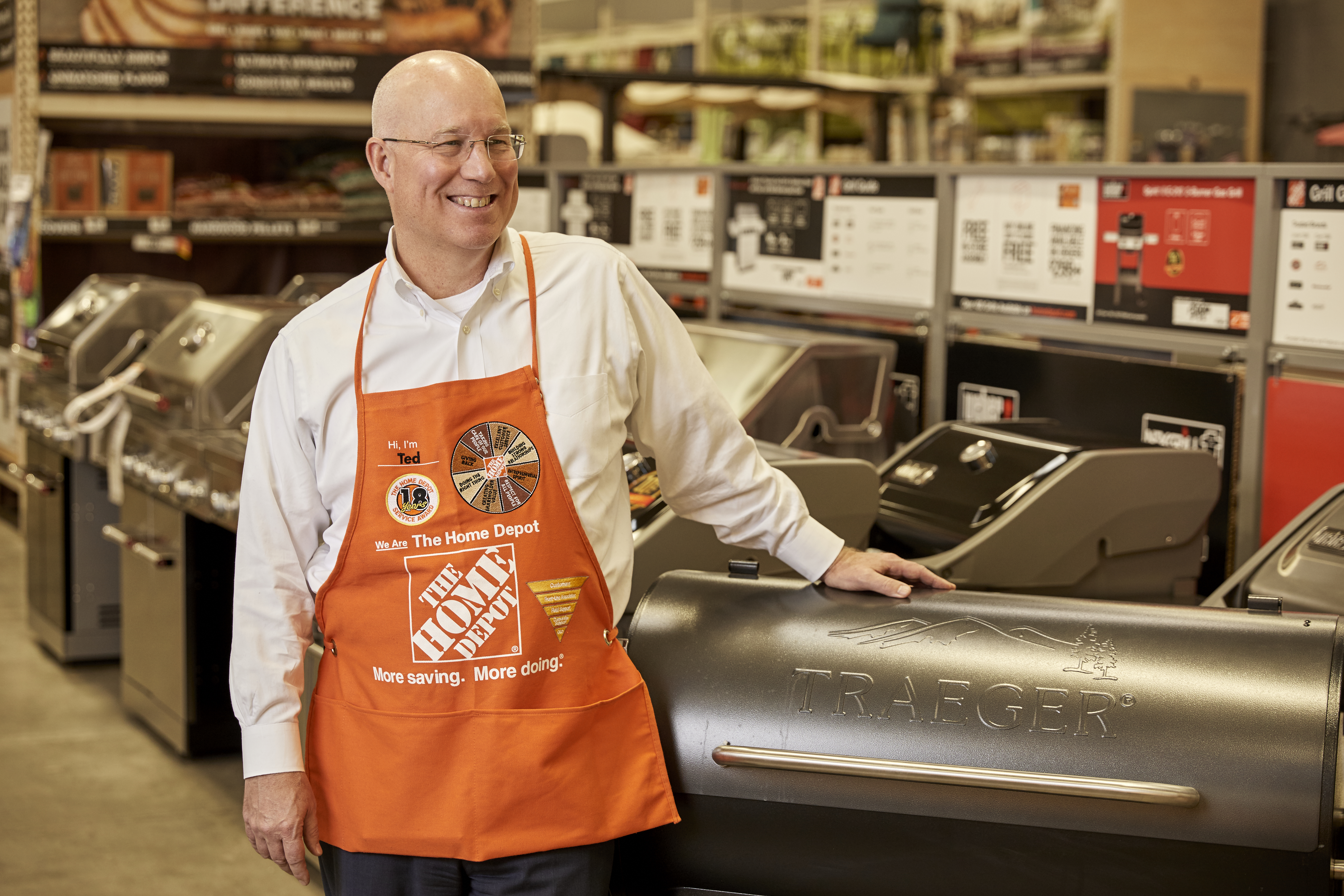 EVP of Merchandising Ted Decker with Traeger grill