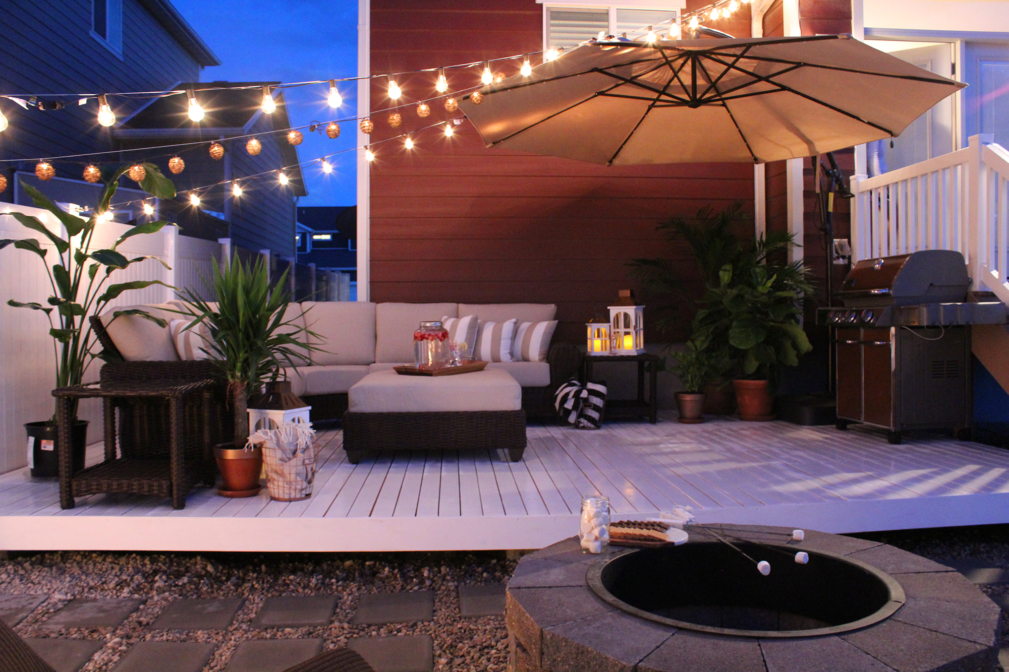 Patio Set Featuring String Lights And LED Andles  Home Depot Patio