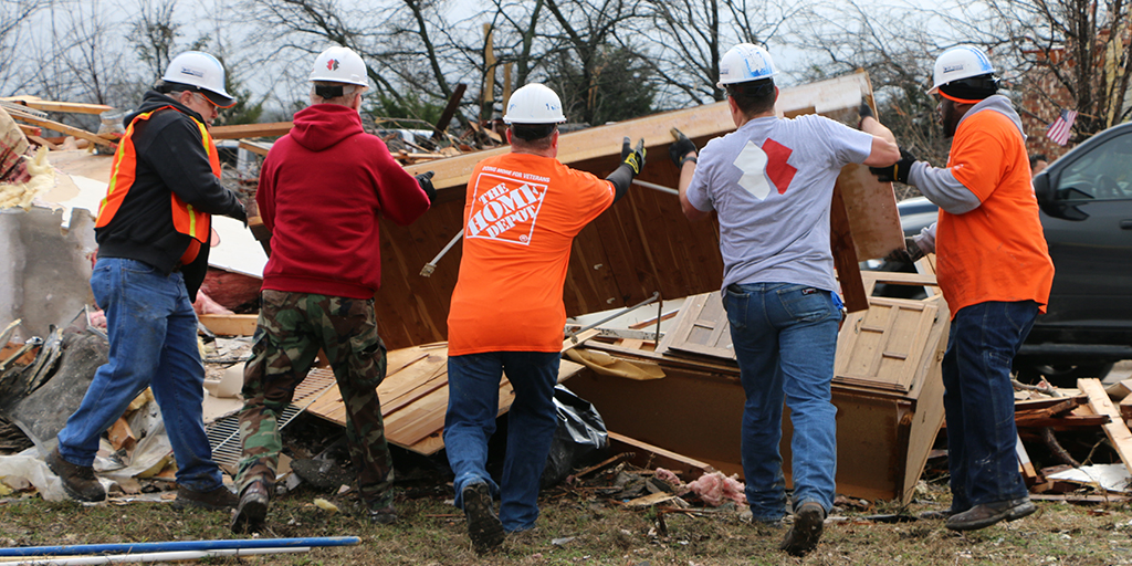 Team Depot and Team Rubicon volunteers clearing storm debris