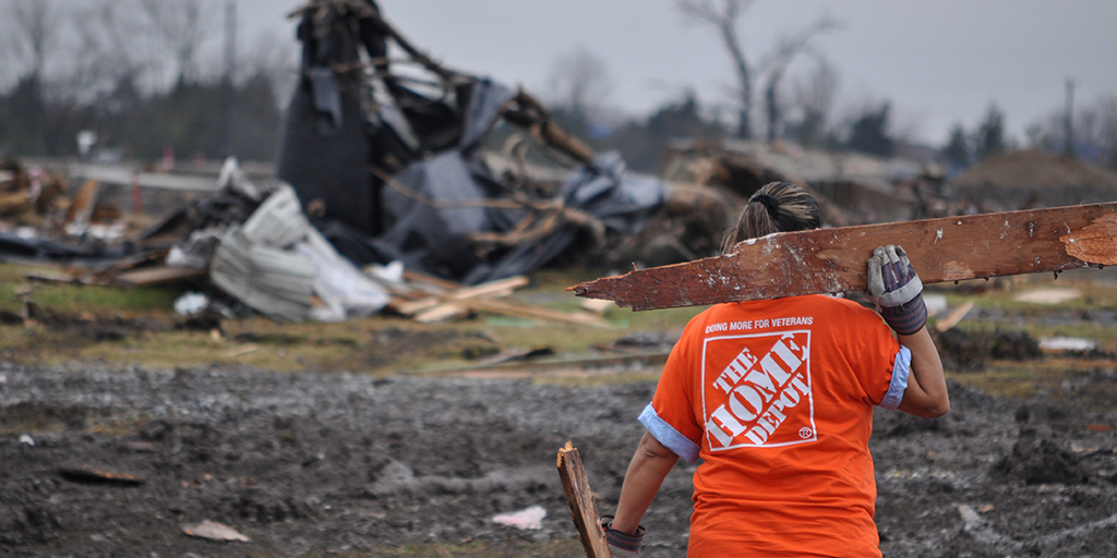Home Depot volunteer clearing tornado debris