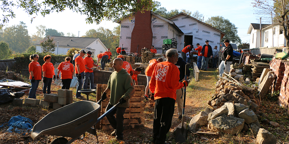 Team Depot volunteers at work in Ace's yard