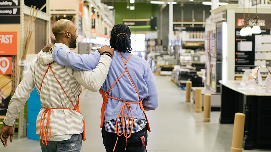 Home Depot associates in store aisle