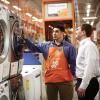 Home Depot associate points to eco-friendly product