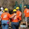 Home Depot Associates Walking Through Hurricane Cleanup