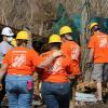 home depot associates walking through hurricane cleanup