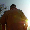 Veteran walking outside of home
