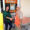 Carmin greeting customer