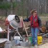 Cara pouring concrete