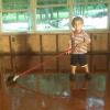 Cara's son cleaning up floor