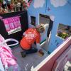 Volunteer works on playhouse