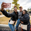 Volunteers take a service selfie
