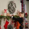 Sarah Fisburne decorating a space for the holidays