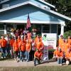 Team Depot volunteer group outside finished Cruse home
