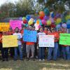 Team Depot volunteers with welcome home signs