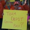 Team Depot volunteer holding sign