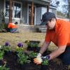 Team Depot volunteer planting flowers