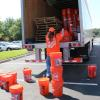 Volunteer packing truck with hurricane relief kits