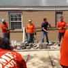 Noah Galloway and Team Depot volunteers working on veteran's patio