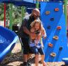 Navy veteran hugs his daughter on playground built by Team Depot