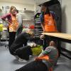 Team Depot volunteer assembling work bench