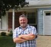 Home Depot Store Manager stands outside his home