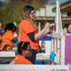 Team Depot volunteer painting playhouse