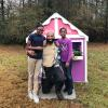 Davis family outside playhouse