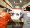 Team Depot and Team Rubicon gather supplies in a Home Depot store