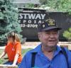 WWII veteran watches as Team Depot volunteers renovate his home