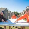 Team Depot volunteers measuring materials
