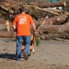 Team Depot volunteer with wheelbarrow clearing debris