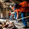 Home Depot volunteers mucking house