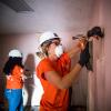 Home Depot volunteer working in Houston home