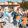 Home Depot volunteers building playhouses