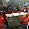 Volunteers carry refrigerator