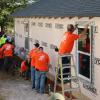 Volunteers work outside Ace's home