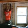 Volunteer hangs insulation